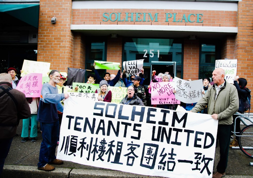 "Solheim Place tenants protest and chant in English, Cantonese, Mandarin, French and Spanish: ""What do we want? Elevator! When do we want it? Now!"" (Nat Lowe)"
