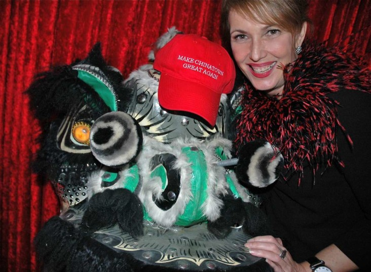 "Chinatown Foundation 2016 Gala Master of Ceremonies Gloria Macarenko poses with a Donald Trump-style red hat that reads ""Make Chinatown Great Again."" (Province)"