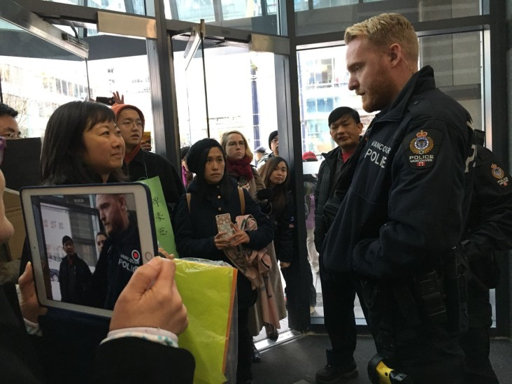 "On February 26, 2018, Chinatown residents and allies stormed Beedie Group's corporate offices demanding withdrawal of the development permit appeal. Police stopped Chinatown elder Mrs. Chen, affectionately known as Kong Tai, from delivering the letter because she was deemed a ""security threat"". The city's board of variance refused to hear the appeal. (Nat Lowe)"